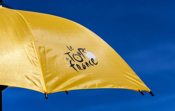 Paris,France,July 22,2012: Image of a yellow parasol with the official logo of Le Tour de France ,against a blue sky.