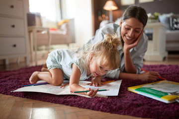 Adorable kid with female drawing indoor