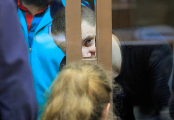A crew member of Ukrainian naval ships, which were seized by Russia's FSB security service in November 2018, attends a court hearing in Moscow