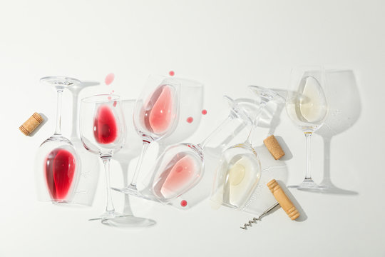 Flat lay composition. Corkscrew, glasses with different wine on white background