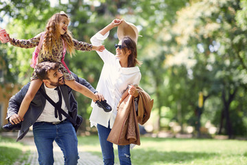 family having fun in park after school