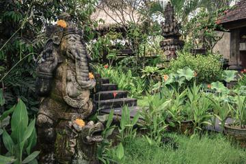 Stone Ganesha statue in garden