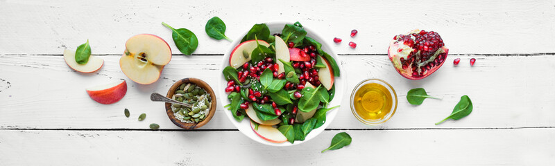 Fotobehang - Spinach, apple salad with pomegranate seeds