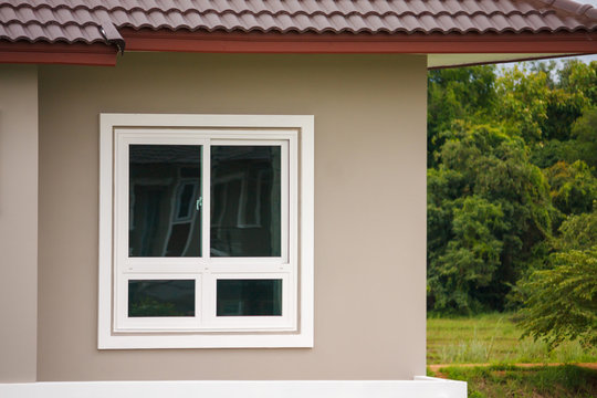Modern window frame outside the house