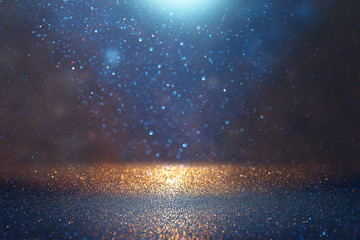 Fototapete - blackground of abstract glitter lights. blue, gold and black. de focused
