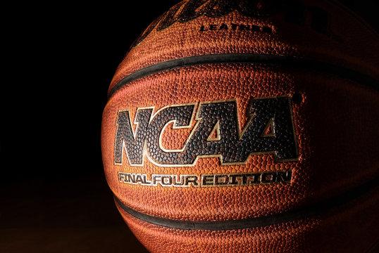 RALEIGH,NC/USA - 12-13-2018: A Wilson NCAA Final Four Edition basketball on hardwood with a dark background
