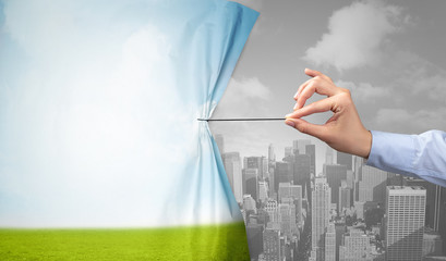 hand pulling nature cityscape curtain to gray cityscape, environmental protection concept