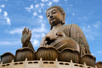 Asia, China, Hong Kong, Lantau Island, Ngong Ping. The giant bronze Tian Tan Buddha statue sits on a lotus throne.