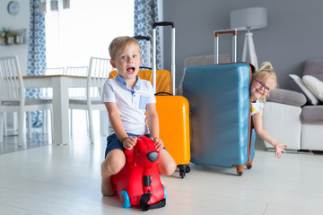 Kids with baggages ready to go for sun holidays