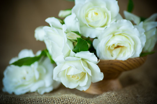 bouquet of beautiful white roses on burlap tablecloths