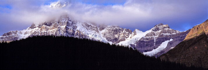 Wall Mural - Canada, Alberta, Mt. Chephren. Clouds descend on the snow-marked flanks of Mt. Chephren, Banff NP, a World Heritage Site, Alberta, Canada.