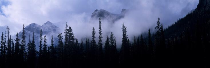 Keuken foto achterwand Hemel Canada, Alberta, Banff NP. Clouds swirl around mountain peaks above Lake Louise Junction in Banff NP, a World Heritage Site, Alberta, Canada.