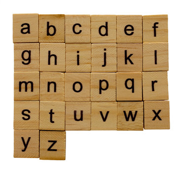 Alphabet letters( a-z )on wooden scrabble pieces, isolated on white background with clipping path.