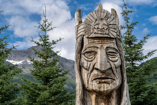 AUGUST 9 2018 - VALDEZ, AK: Trail of the Whispering Giants totem pole statue in Valdez Alaska, by artist Peter Wolf. These are found in all 50 US States