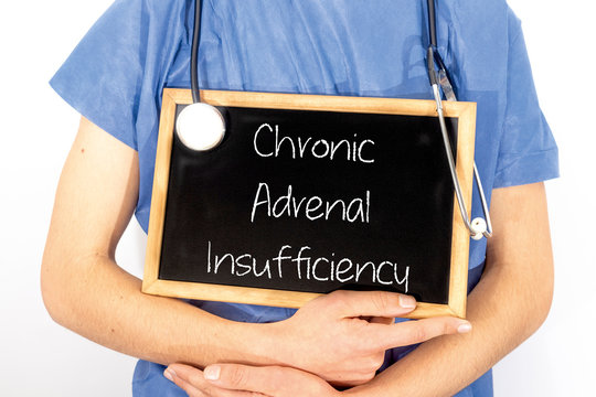 Doctor shows information on blackboard: chronic adrenal insufficiency.  Medical concept.