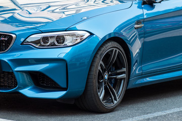 retail of blue coupe  BMW M3 parked in the street. BMW is a german brand multinational company which currently produces automotive