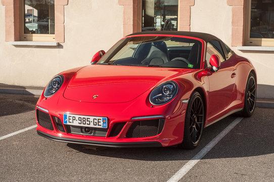 red Porsche 911 GTS carrera in outdoor parking