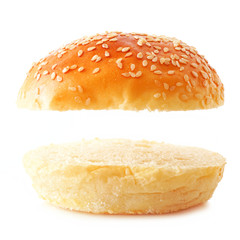 Open sesame seed hamburger bun on a white background. Top and bottom isolated with copy space.