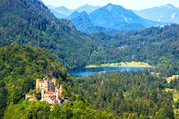 Hohenschwangau Castle in Alps, Bavaria, Germany. Aerial scenic view of beautiful castle with...