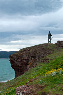 Greenland, Erik's Fjord. The hilltop statue of famous Norse explorer Leif Erikson overlooking the village of Qassiarsuk.