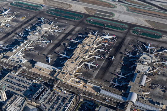 Afternoon aerial view of busy terminals at LAX on August 16, 2016 in Los Angeles, California, USA.
