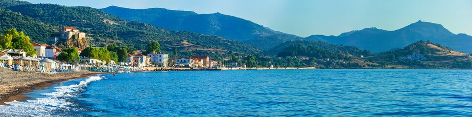 Lesvos island . Greece. Beautiful coastal village Petra with famous monastery on the rock and great beach Fototapete