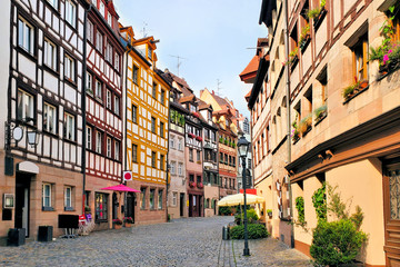 Fototapete - Beautiful street of half timbered houses in the Old Town of Nuremberg, Bavaria, Germany