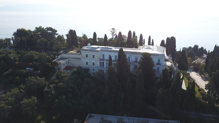 Aerial drone photo of iconic Palace of Achileion former residence Empress Elisabeth of Austria (known as 'Sissi') and Kaiser William II of Germany, Corfu island, Ionian, Greece