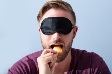 Blindfolded Man Testing Food