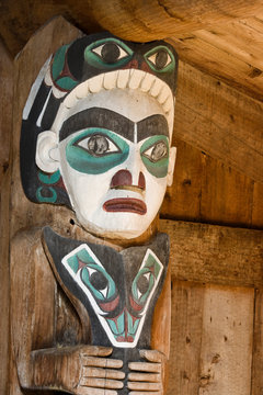 USA, Alaska, Kasaan. Close-up of human figure on totem pole in Indian longhouse.