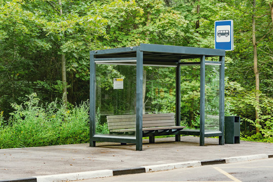Empty bus stop in the summer forest.