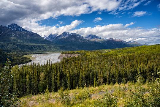 Glacial water melt river in valley in mountain range in Alaska