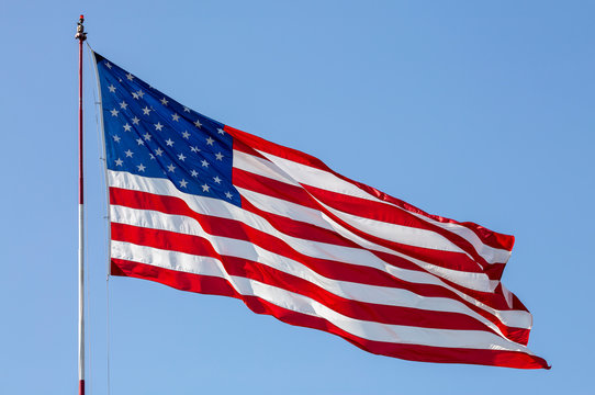 USA, California, San Diego. American flag waves above Liberty Station