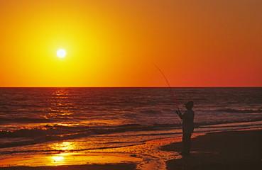 North America, USA, Florida, Sanibel Island. Fishing at sunset.
