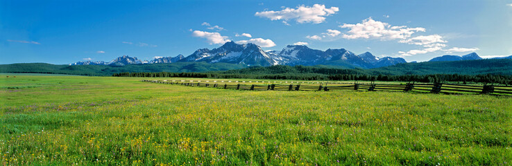 Wall Murals Meadow USA, Idaho, Sawtooth NRA. A split-rail fence extends to the Sawtooth Range at Sawtooth NRA, Idaho.