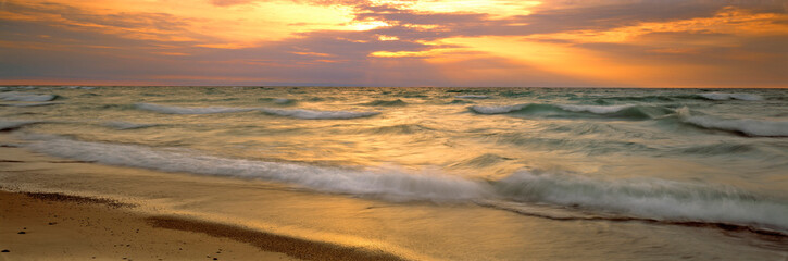 USA, Michigan, Pictured Rocks NL. The sun flares over Lake Superior at Pictured Rocks National Lakeshore, Michigan.