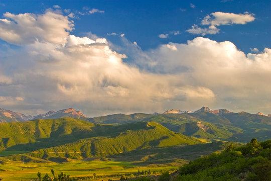 USA, Colorado, Aspen, Old Snowmass Valley. Summer sunset on green mountain vista.