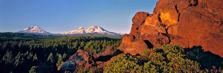 USA, Oregon, Three Sisters. Three Sisters take on a pink hue at sunrise, Cascades Range, Oregon.