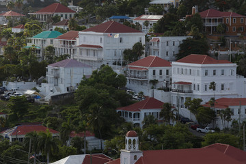 An American flag flies at the Office of the Lieutenant Governor in Charlotte Amalie
