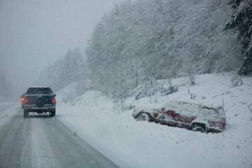 NA, USA, Washington State, Olympic Peninsula, Hwy 104, Cars in Blizzard Conditions Passing a Wrecked Car