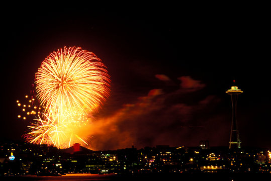North America, USA, Washington State, Seattle, Lake Union. Fireworks over Key Arena and the Space Needle