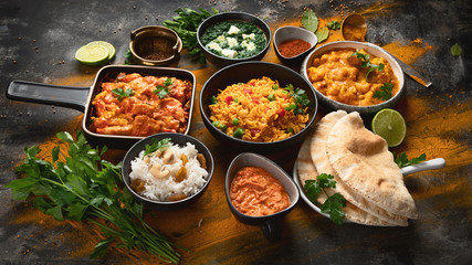 Assorted indian food on black background.. Fotomurales