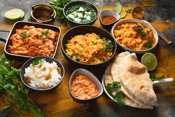 Fototapete - Assorted indian food on black background..