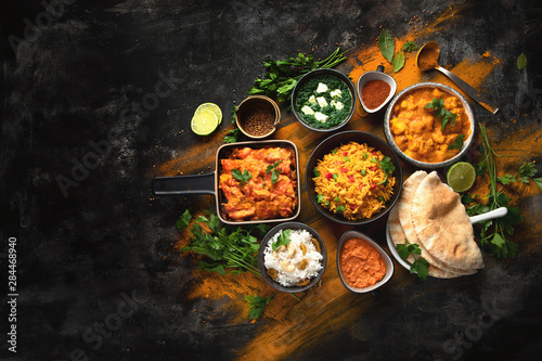 Fototapete Assorted indian food on black background..