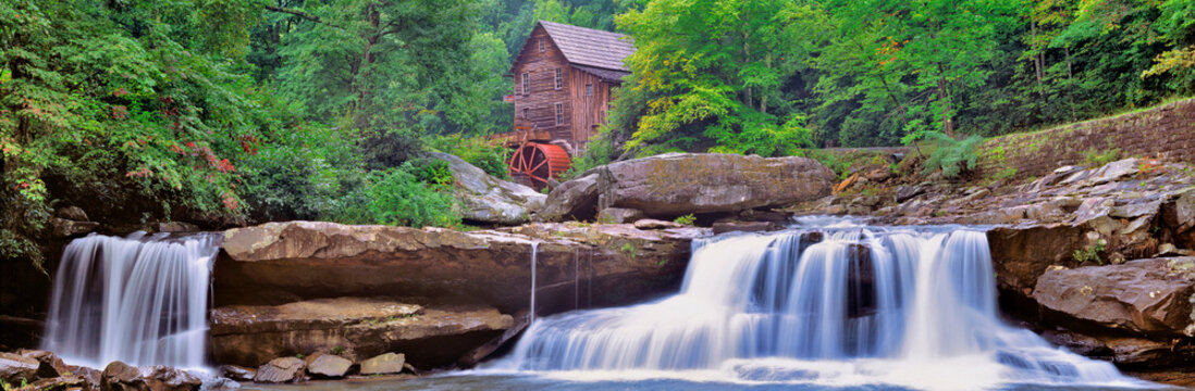 USA, West Virginia, Babcock SP. Two waterfalls form the foreground for Glade Creek Grist Mill, in Babcock State Park, West Virginia.