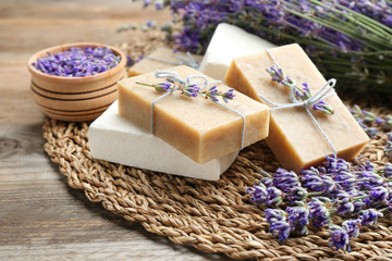 Wall Mural - Handmade soap bars with lavender flowers on brown wooden table