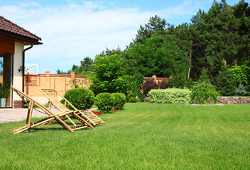 Canvas Prints Pistachio Wooden deck chairs in garden on sunny day