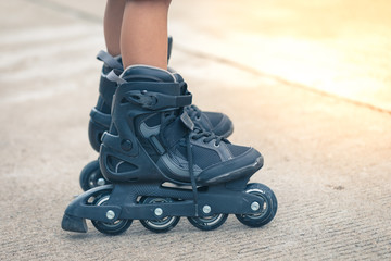 Closeup inline rollerblade on the legs
