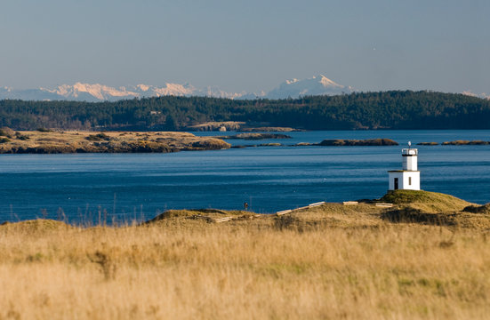 USA, WA, San Juan Islands. Cattle Point light with superb vistas of Lopez Island and Cascade Mountains on mainland Washington.