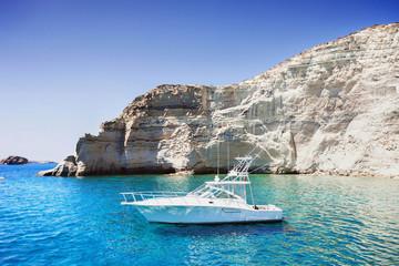 Sailboat in a beautiful bay, Milos island, Greece